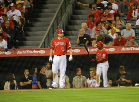 Mark Trumbo stands at the plate and puffs out his checks with impatience during a time out for a meeting on the mound. Alberto Callaspo is in the on deck circle. Angels vs. Nationals, June 27, 2011. Photo by This is a very simple game...