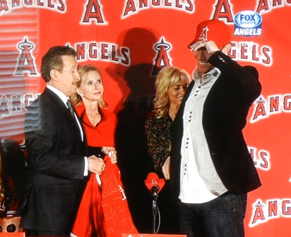 Yes, I couldn't make it to the presser so I took a photo of it on my TV. No, it's not a full face shot. But I just loved Josh Hamilton's big happy smile as he put on that gorgeous Angels ballcap. Welcome to the team, Josh! Photo by This is a very simple game...