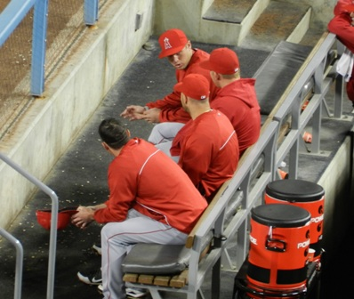 From 2012's Spring Training Freeway Series games: Peter Bourjos entertains Mark Trumbo and other teammates on the bench...a location I sincerely hope neither Bourjos nor Trumbo will be seeing much of this season. Angels at Dodgers, April 3, 2012. Photo by This is a very simple game...