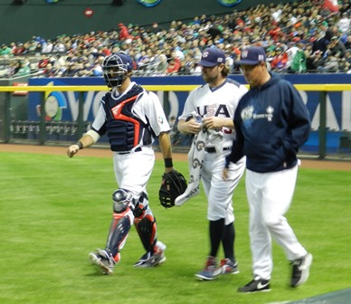And can we get a standing ovation? Well, we were standing and clapping for everything anyway -- this was a delightfully excited crowd -- so why not. R.A. Dickey and J.P. Arencibia head for the dugout after warm ups. World Baseball Classic, USA vs. Mexico, March 8, 2013. Photo by This is a very simple game...
