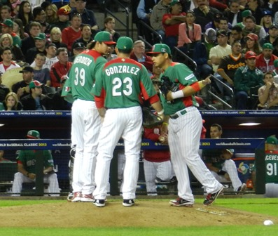 Adrian Gonzalez and Ramiro Pena join Luis Mendoza for a meeting on the mound. World Baseball Classic, USA vs. Mexico, March 8, 2013. Photo by This is a very simple game...
