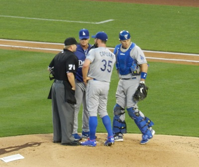 The umpire asks Chris Capuano, A.J. Ellis and Don Mattingly to wrap it up. 'Enough talking already Chris. Yes, it's still Josh Hamilton. Yes, he still swings at everything. Yes, he still hits most of it...really far.' ...of course, this game Hamilton didn't hit anything he swung at, but life goes on. Freeway Series, Angels vs. Dodgers, May 29, 2013. Photo by This is a very simple game...