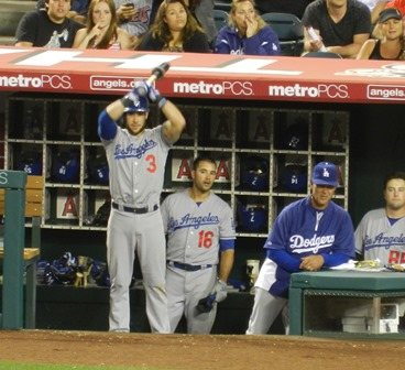 And another sight we love to see - a fresh off a strike out, pouty Andre Ethier jawing in the dugout. Skip Schumaker looks amused and Donny Baseball is having none of it. Freeway Series, Angels vs. Dodgers, May 29, 2013. Photo by This is a very simple game...