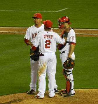 Ernesto Frieri, Erick Aybar and Chris Iannetta chat on the mound. 'Woah, it really landed all the way over there!! Dammit Aybar, why you gotta go and tell me these things during the game?!?' Freeway Series, Angels vs. Dodgers, May 29, 2013. Photo by This is a very simple game...