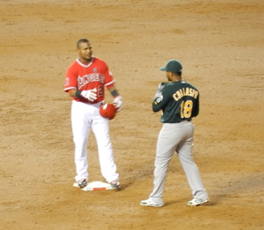 """The brothers,"" Erick Aybar and Alberto Callaspo, separated once again by trades, greet each other on the base paths. 'Miss you, Bro!' 'Miss you more!' *snerk* Okay, probably their exchange was less girly and more peppered with friendly insult that that but, hey, it amused me. Angels vs. A's, September 23, 2013. Photo by This is a very simple game..."