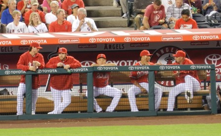 Hank Conger caught daydreaming in the dugout...or is he? Angels vs. A's, September 23, 2013. Photo by This is a very simple game...