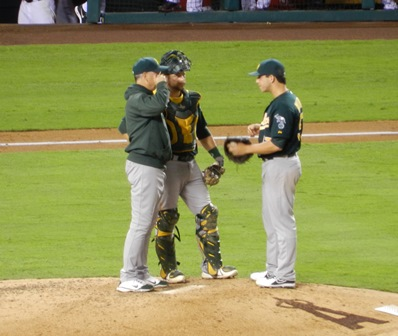 The A's having a meeting on the mound. Pitcher Tommy Milone appears to be explaining something emphatically to catcher Stephen Vogt and Pitching Coach Curt Young. Perhaps, 'You know guys, it really makes me feel insecure when the infield can't make the play.' I for one found this imaginative scenario wildly hilarious...right up until the A's started kicking some serious Angels ass. *FacePalm* Angels vs. A's, September 23, 2013. Photo by This is a very simple game...