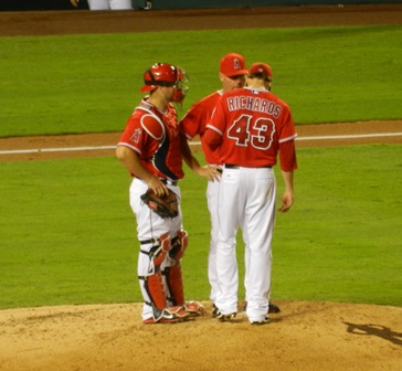 Garrett Richards, Chris Iannetta and Mike Butcher meet on the mound. Richards pitched really well...except for when he gave up homeruns and walked guys and stuff, naturally. Ugh. Sadly photo pretty much summed up the evening's starting pitching experience for me. Angels vs. A's, September 23, 2013. Photo by This is a very simple game...