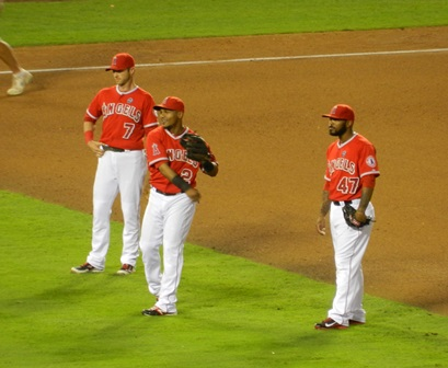 Andrew Romine, Erick Aybar and Howie Kendrick laugh as they warm up in between innings. Kendrick was this evening's offense, driving in 4 of the 5 Angels runs. Angels vs. A's, September 23, 2013. Photo by This is a very simple game...