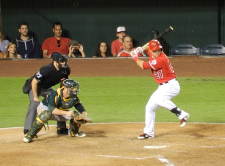 Mike Trout at bat. Seriously, when he's on, I could watch this kid's gorgeous swing all day. Trout went 1 for 4 this evening. Angels vs. A's, September 23, 2013. Photo by This is a very simple game...