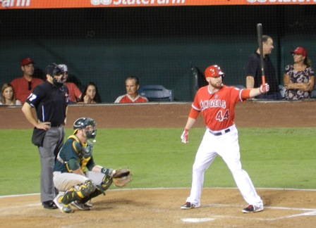 Mark Trumbo holds aloft his magic bat and says, 'Come on, Meat. Show me some of that...' Okay, so I like mixing my references a tad too much. Oh, yeah. And he's probably he's not really saying that either. But you never know, Angels vs. A's, September 23, 2013. Photo by This is a very simple game...